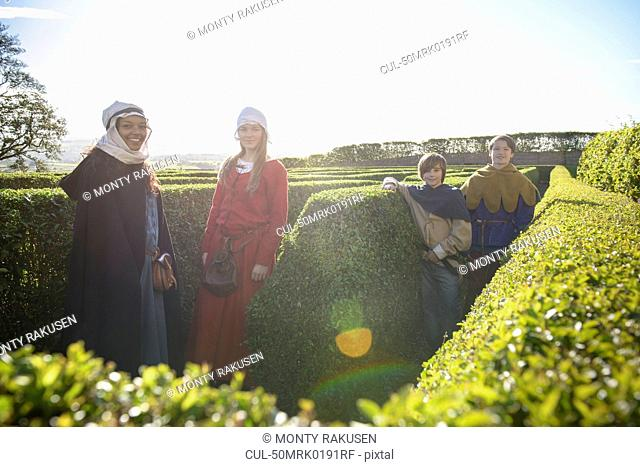 Students in period dress in hedge maze