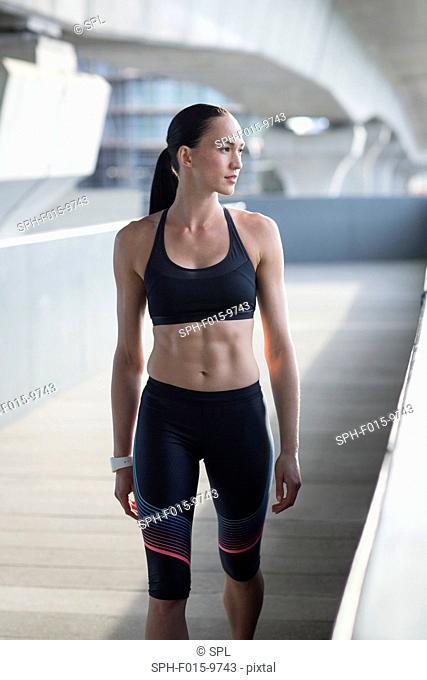 MODEL RELEASED. Portrait of young woman in sports wear
