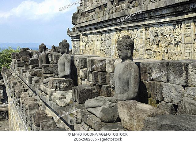 Indonesia-Java-Borobudur, 4th terrace/gallery, life size Buddha figures in Padmasana