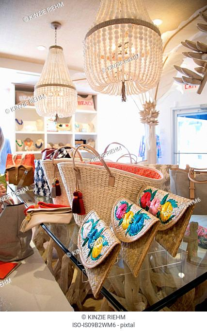 Straw shopping bags and clutch bags in fashion boutique