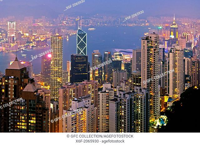 Night view across the skyscrapers in Central District and the Victoria Harbour to Kowloon, Hong Kong