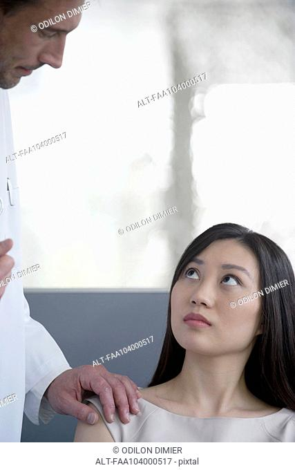 Doctor speaking with concerned patient