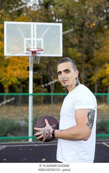 Portrait of man with basketball in autumn