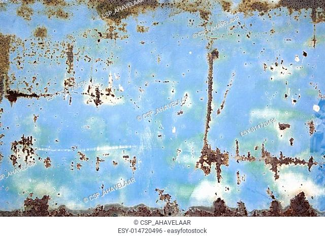 rusty metal with blue and white paint