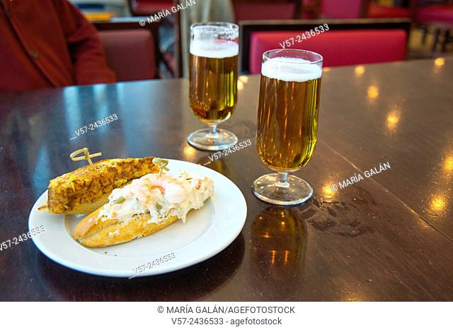 Spanish appetizer: two glasses of beer and two tapas. Madrid, Spain