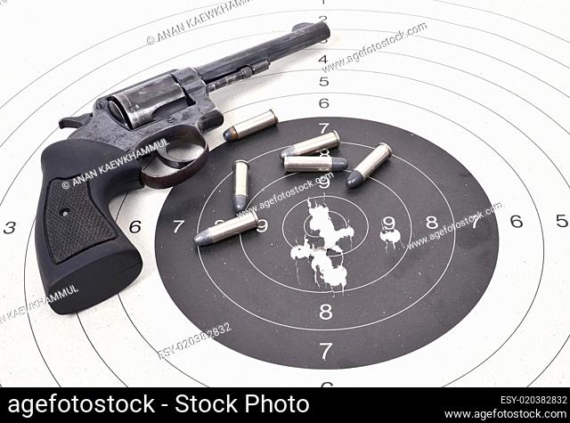 old gun with bullet