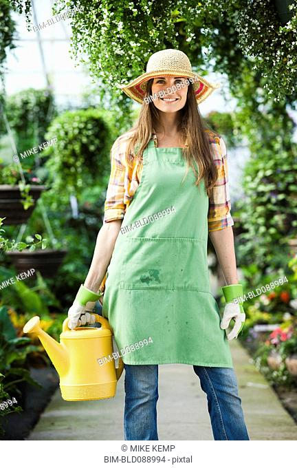 Caucasian woman holding watering can