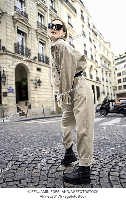 cool fashionable woman at street during fashion week, in Paris, France