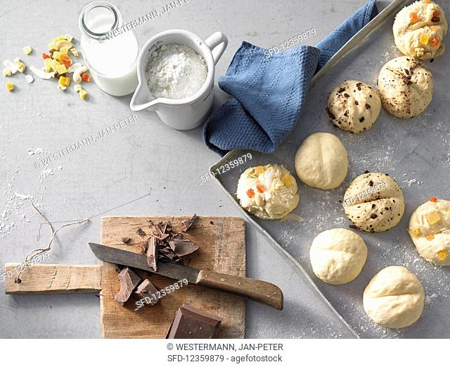 Unbaked sweet bread rolls with ingredients
