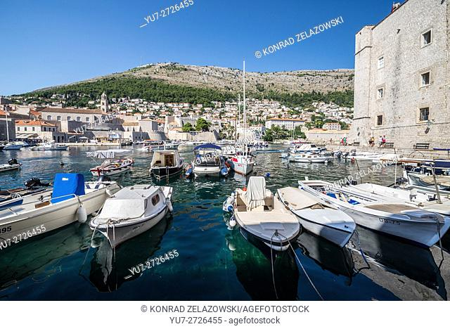 The Old Town Harbour in Dubrovnik city, Croatia. Walls of Saint John Fortress on the right side