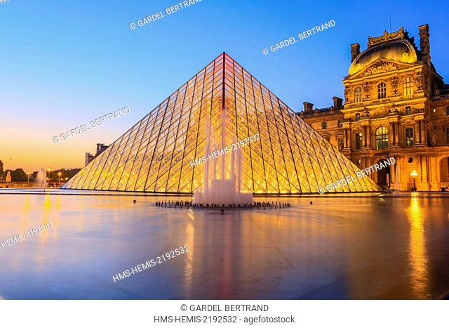 France, Paris, area listed as World Heritage by UNESCO, the Louvre Pyramid by the architect IM Pei and facade of the Cour Napoleon