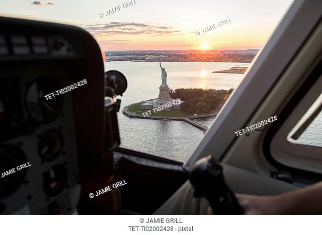 Cockpit in helicopter and Statue of Liberty