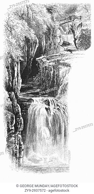 1870: Visitors on the old wooden bridge viewing the Bracklinn Falls, a series of waterfall on the course of the Keltie Water