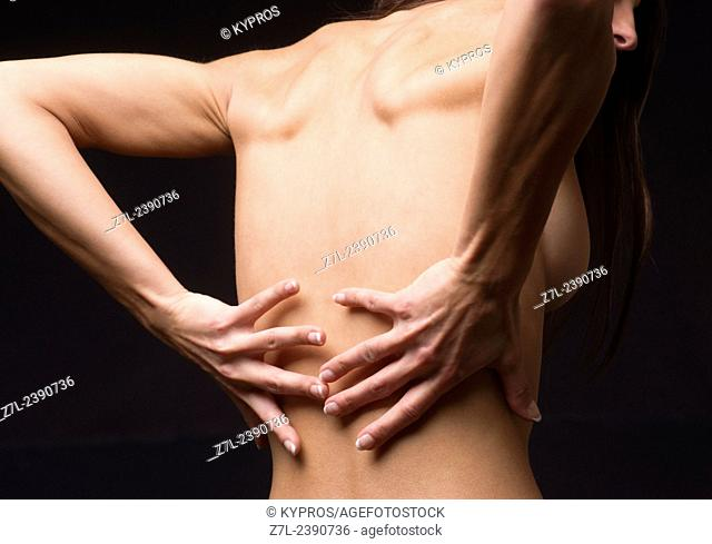 Young Woman's Hands On Lower Back