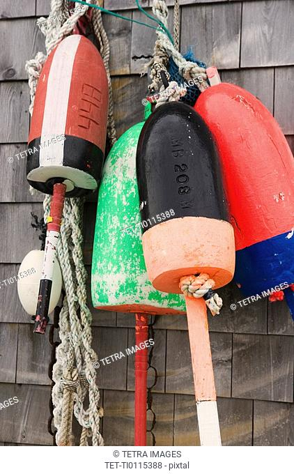 Buoys on a wall in Maine