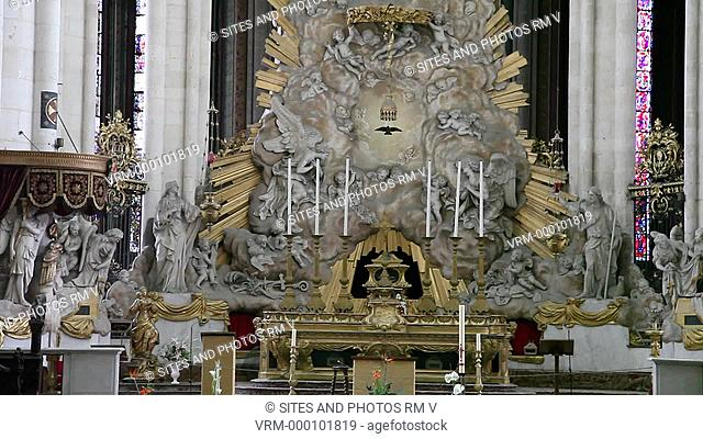 TILT up. CU. Interior: The Baroque-style High Altar was designed by Pierre Joseph Christophle in the late 18th century. The Cathedral is in the High Gothic or...