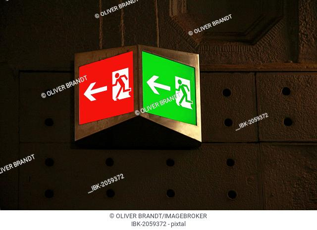 Emergency exit sign, illuminated pictograms, green and red, strange colour, fire prevention, evacuation route
