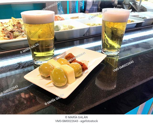 Two glasses of beer and tapa in a bar. Spain