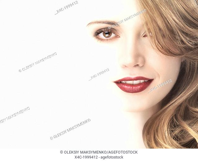 Closeup beauty portrait of a beautiful young woman face blending into white beige light background
