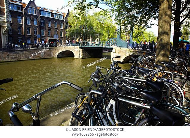 Netherlands, North Holland, Amsterdam  Bicycles left alongside the banks of the River Amstel in Amsterdam City