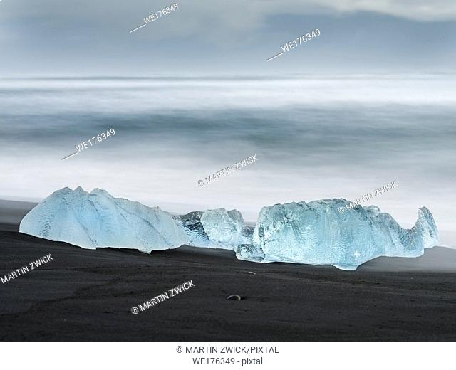 Icebergs on black volcanic beach. Beach of the north atlantic near the glacial lagoon Joekulsarlon and glacier Breithamerkurjoekull in the Vatnajoekull NP