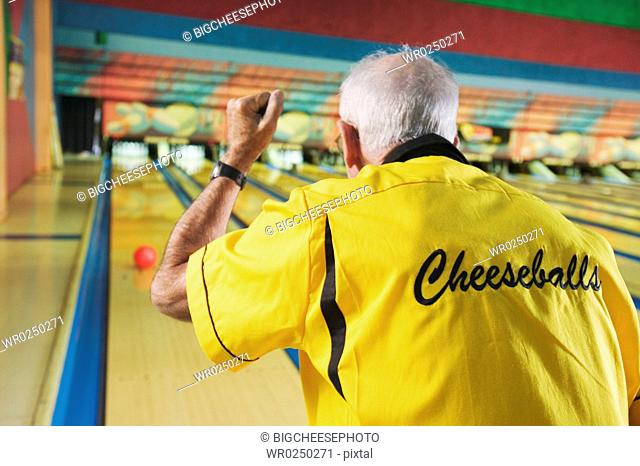 A senior man bowling