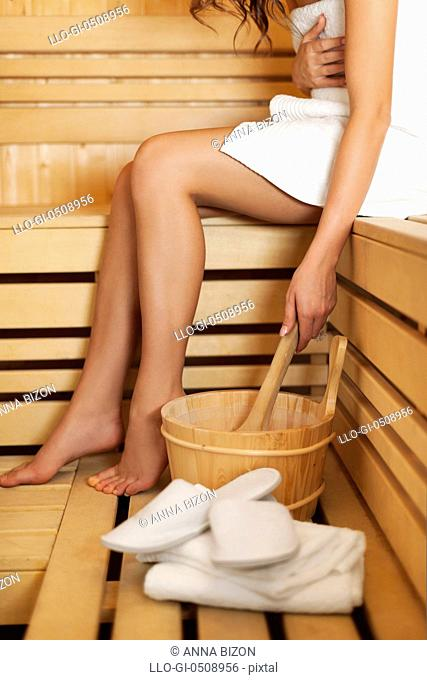 Woman relaxing and using sauna accessories Debica, Poland