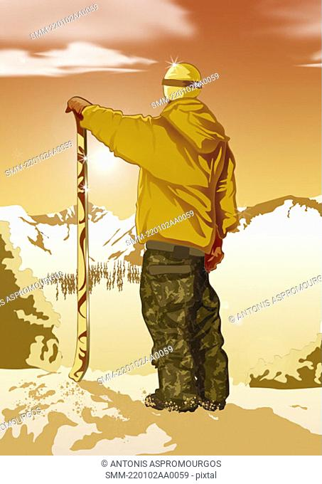 Man standing looking at view with his skis