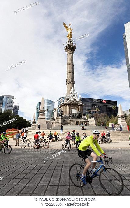 Car Free Sunday along Paseo De La Reforma - Colonia Cuauhtémoc, Mexico City, Federal District, Mexico. Cyclists are riding around El Ángel de la Independencia
