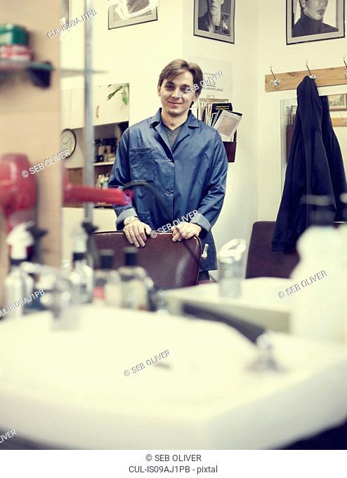 Barber smiling in barbershop, portrait