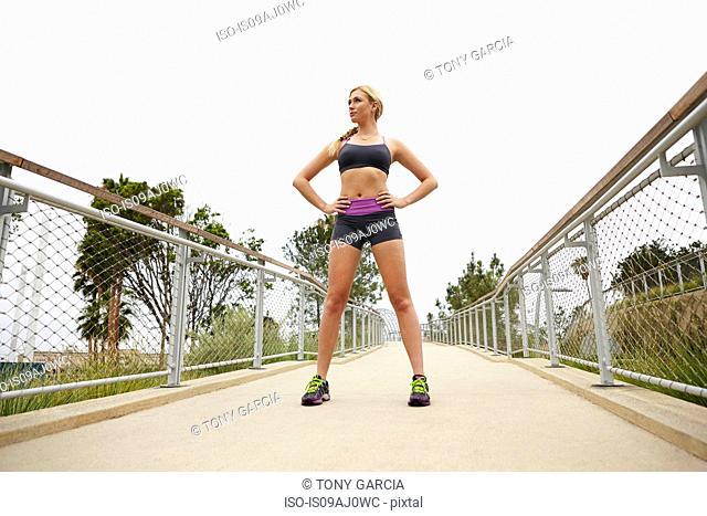 Woman standing on bridge