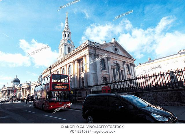 London's iconic Red Bus passing in front of St Martin-in-the-Fields Church, London, UK, London