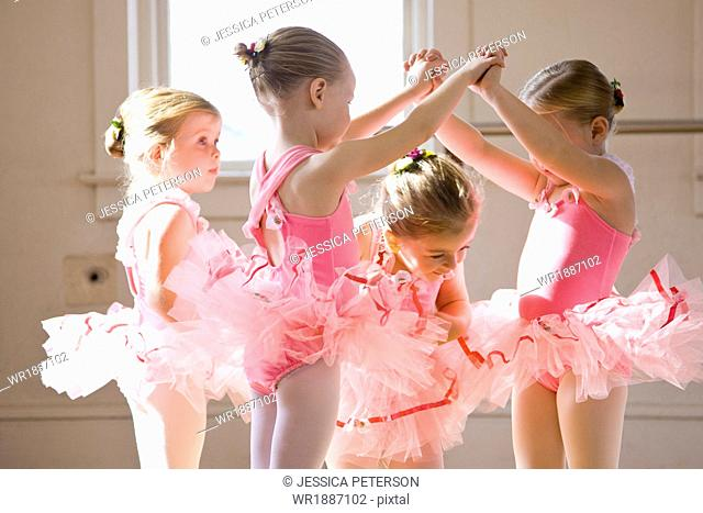 Four girls (2-3,4-5) practicing in ballet studio