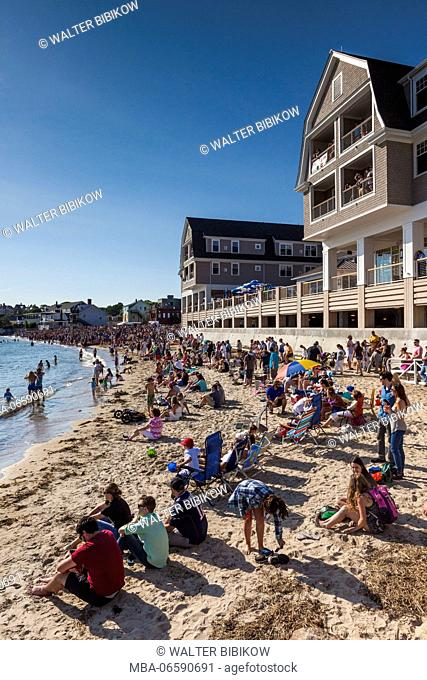 USA, Massachusetts, Cape Ann, Gloucester, St. Peter's Fiesta, Italian-Portuguese fishing community festival, Pavillion Beach spectators by the new Beauport...