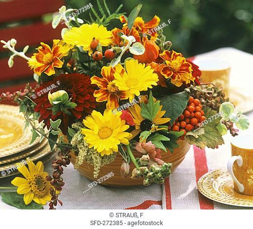 Arrangement of marigolds, Tagetes and dahlias