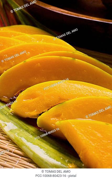 Studio shot of papaya cut in slices