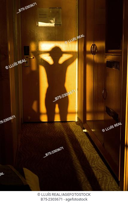 Shadow of the body of a woman in the hallway of a hotel room at the Dead Sea, Israel, Middle East