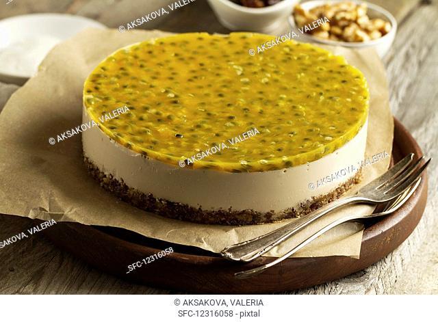 Mascarpone and Greek yoghurt cheesecake with a date and walnut base, topped with maracuja