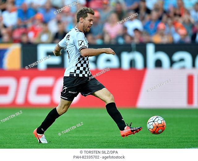 Sebastian Vettel in action during a charity soccer match with Dirk Nowitzki and Sebastian Vettel in Mainz, Germany, 27 July 2016