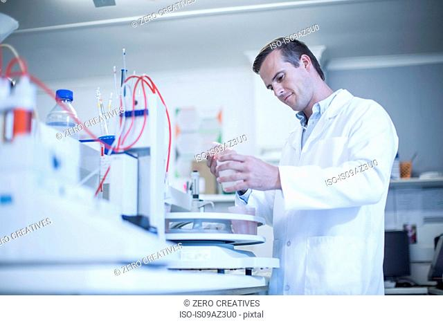 Mid adult man working in laboratory