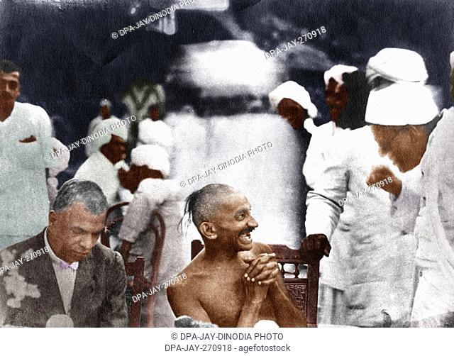 Mahatma Gandhi at a party given by Srinivas Iyengar (right), Madras, India, September 1921