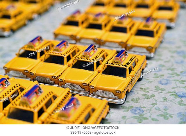Toy Replica Checker Yellow New York City Taxi Cabs, Displayed on a Street Vendor's Table