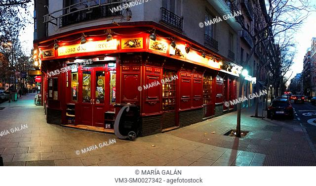 Tavern, night view. Alcantara street corner to Juan Bravo street, Madrid, Spain