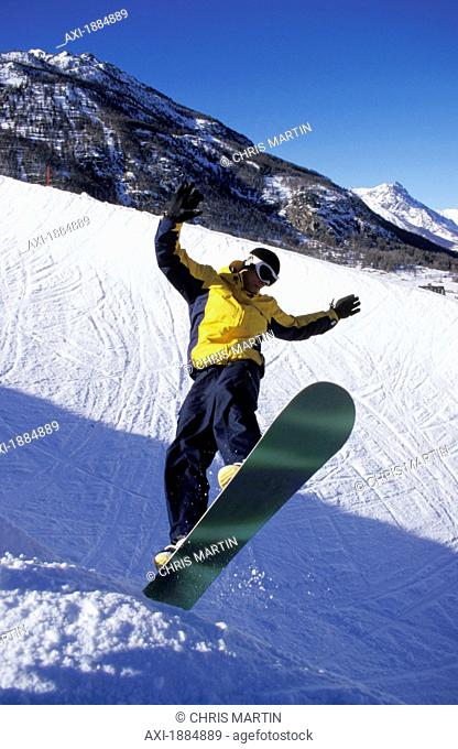 Man Jumping On Snowboard In The Alps