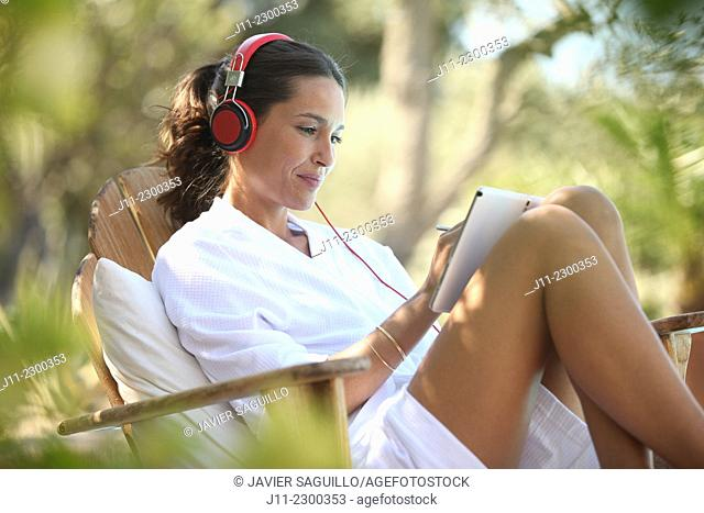 Woman with digital tablet and headphones