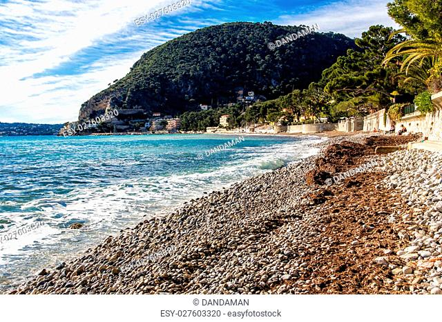 Beach of Eze sur mer in south of france with mountain in the background