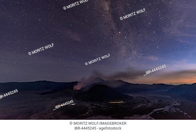 Night sky with stars, smoking volcano Mount Gunung Bromo, Mount Batok in front, Mount Kursi at back, Mount Gunung Semeru, Bromo Tengger Semeru National Park