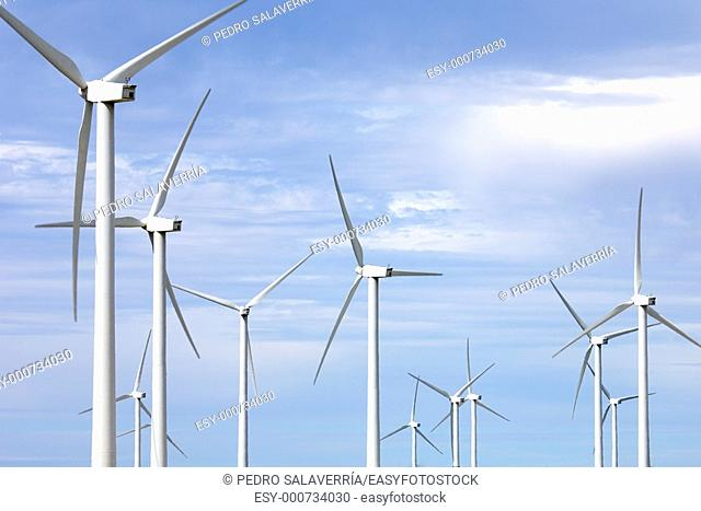 group of windmills with cloudy blue sky, Fuendetodos, Saragossa, Aragón, Spain