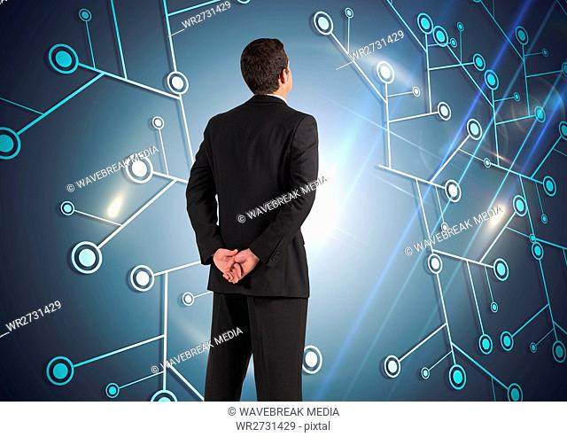 Composite image of Businessman Standing and looking at Graphic
