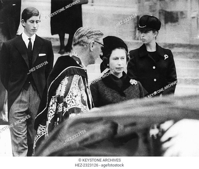 The Reverend Robin Wood has a word with the Queen at the funeral of her aunt Princess Marina, 1968. Prince Charles and Princess Anne are in the background